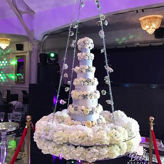 Floral swinging wedding cake