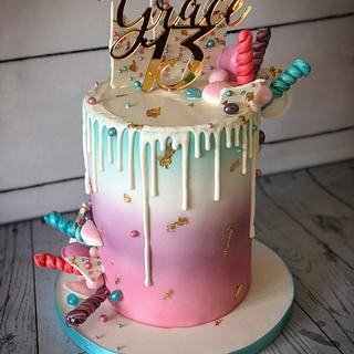 Pastel drip cake with gold accents