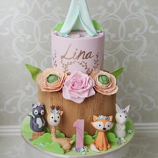 Whimsical Woodland 1st Birthday cake https://www.designedbymani.com/