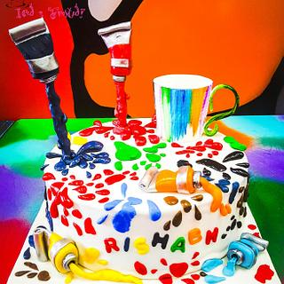 Gravity defying ceramic paint theme cake!