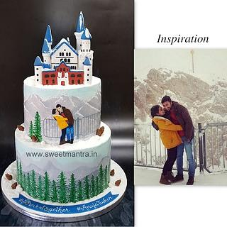 Winter theme hand painted wedding cake with Germany's Neuschwanstein Castle topper