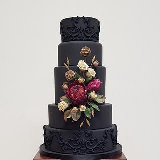 Black wedding cake with dried flower effect sugar flowers