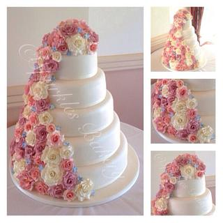 5 tier wedding cake with cascading flowers