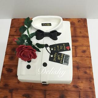 White shirt cake with red rose