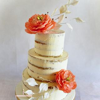 Semi naked wedding cake with sugar flowers