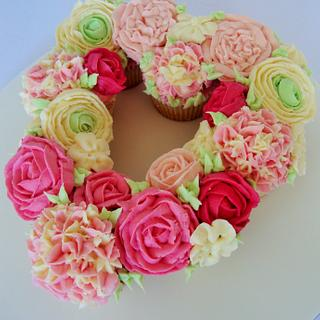 Floral heart cupcake display.
