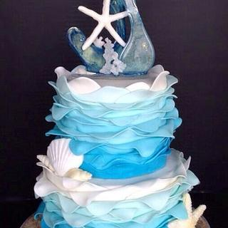 Blue and White Ombre seashell cake with sugar sculpture topper