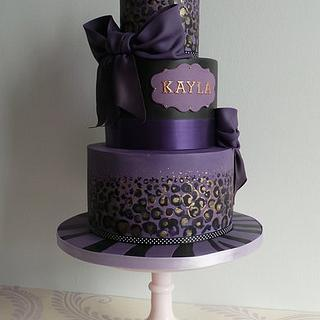 Leopard print in purple, gold and black