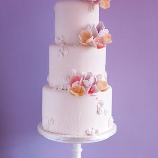 White textured cake with fantasy flowers