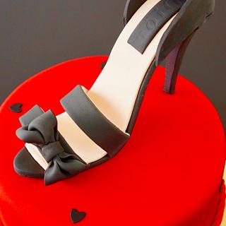 shoes on a red cake - Cake by Arletta