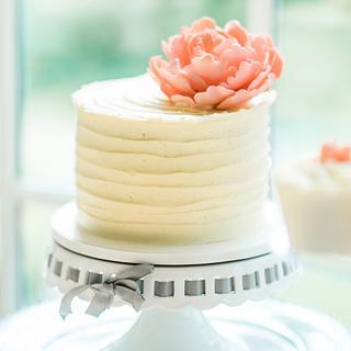 Ivory and peach wedding cake