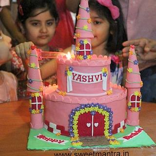 Princess Castle theme 2 tier cake for girls birthday