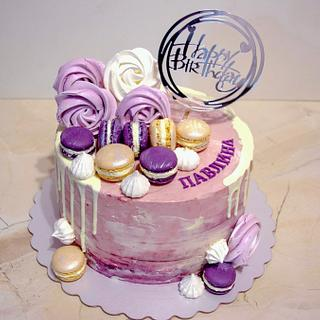 Purple cake with macaroons.