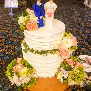 Wedding cake structure with handmade groom and the bride