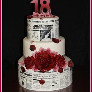 Newspapers and roses cake
