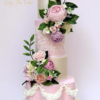 Classy pale pink and ivory wedding cake