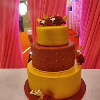 Red n gold wedding cake