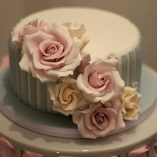 Large striped cake with rose detail