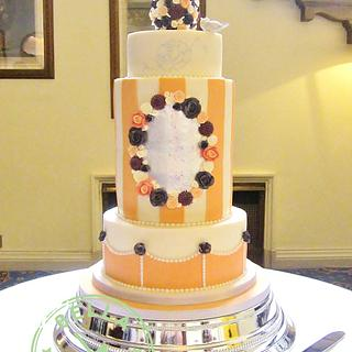 Coral and purple flower wedding cake