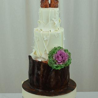 Rustic Cake with Elephant Topper and Ornamental Kale