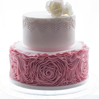 Sugar lace, roses and pink ruffles.  - Cake by Jessie lee cakes
