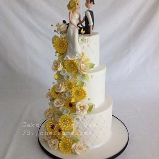 Yellow and cream wedding cake