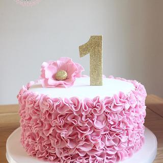 pink ruffles 1st birthday cake