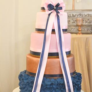 Navy and rose gold wedding cake