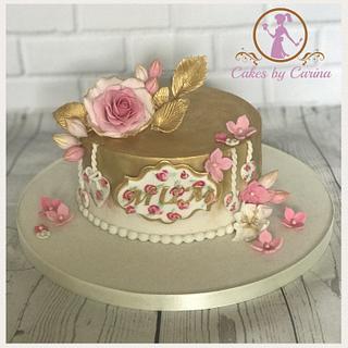 Floral rose and gold leaf cake