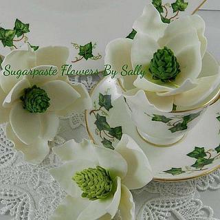Magnolias in ivy leaf tea cups