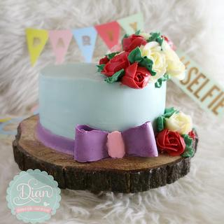 Ribbon bow and flower butter cream cake