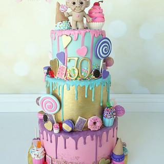Colorful Chocolate Drip Candy and Sweets themed birthday cake