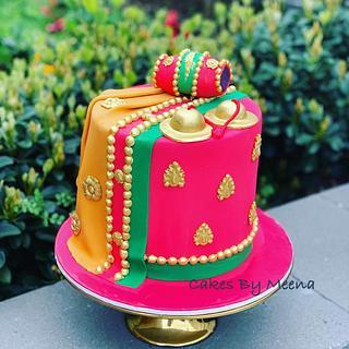 Saree, kartal and dholak cake