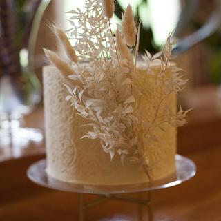 Buttercream cake with stencil detail and dried foliage - Cake by Kasserina Cakes