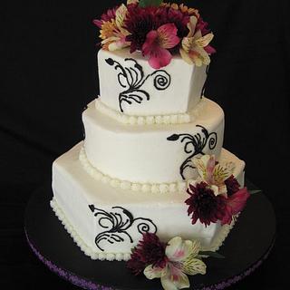 Hexagon and round 3 tiered wedding cake