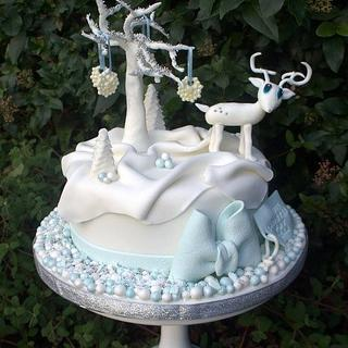 Blue and white reindeer cake