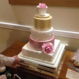 Vintage blush and gold luster wedding cake