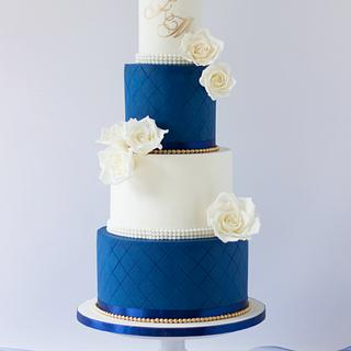 Classy and simple wedding cake in royal blue and white