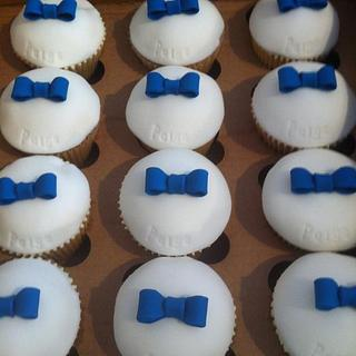 Prom style cupcakes suits and tie.