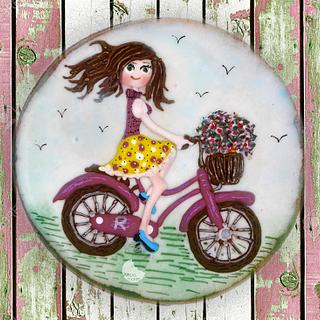 Girl on a bike cookie