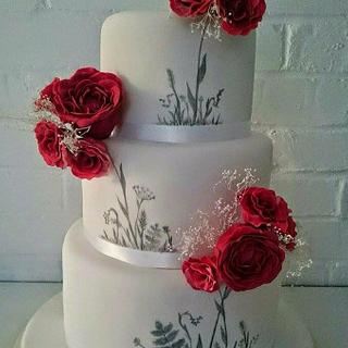 Red and white handpainted wedding cake