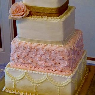 Square pink and gold buttercream wedding cake