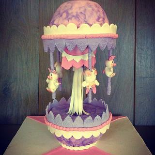 Moving carousel gravity cake