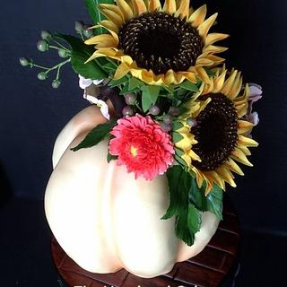 Thanksgiving pumpkin cake with sunflowers and mums
