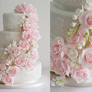 Cascading roses and freesia