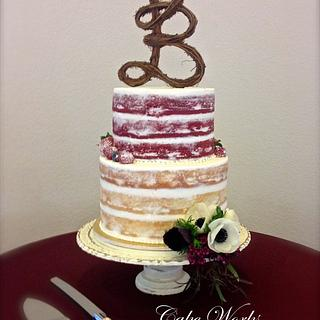 Naked cake with berries and anemone