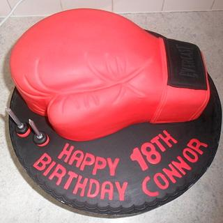 red boxing glove birthday cake