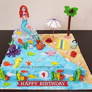 Underwater, Mermaid theme fresh cream cake with Princess Ariel topper for girl's 1st birthday