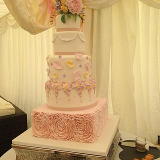 5 tier pastels and ruffles wedding cake