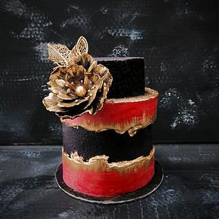 Black - red - gold cake